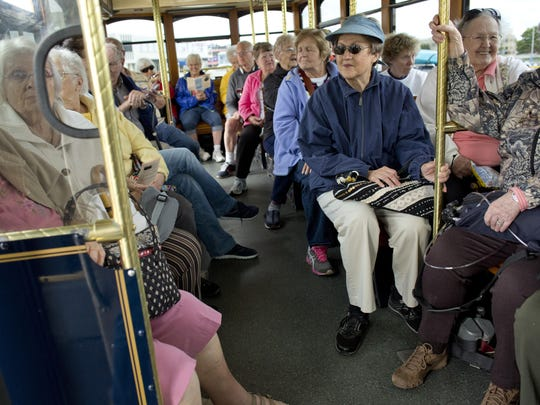 More than 20 people listen during a tour on the Blue Water Area Transit trolley Thursday, August 27, 2015 in Port Huron. The ride, which costs 10 cents, gives riders a tour of Port Huron from landmarks to little-known facts.