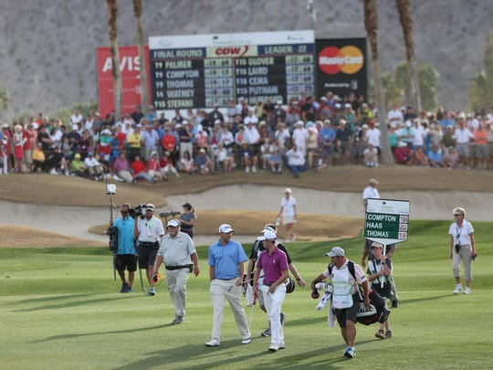 Bill Haas and Justin Thomas make their way to the final green in front of a large crowd during the Humana Challenge at PGA West in January. A recent economic study found 13.9 percent of all golf courses in California are in the Coachella Valley.