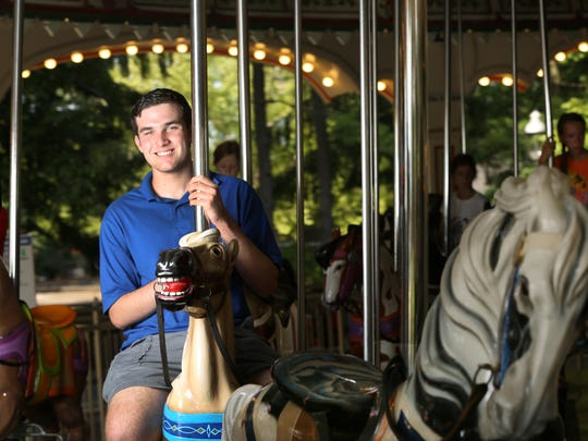 Mikey Mills, a Campbell County High School senior from Cold Spring, Ky., rides the carousel at Kings Island. He is a longtime band organ enthusiast and writes letters to amusement parks around the country, urging them to preserve and use these rare instruments.