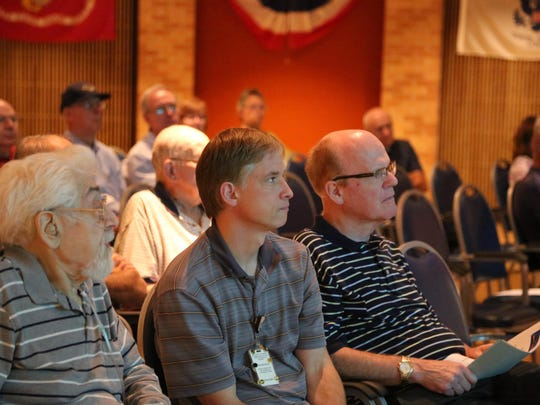 Audience members listen to Kiel Majewski's presentation Thursday, Sept. 3, 2015, on the Holocaust and life of Eva Mozes Kor at the Indiana Veterans' Home in West Lafayette.