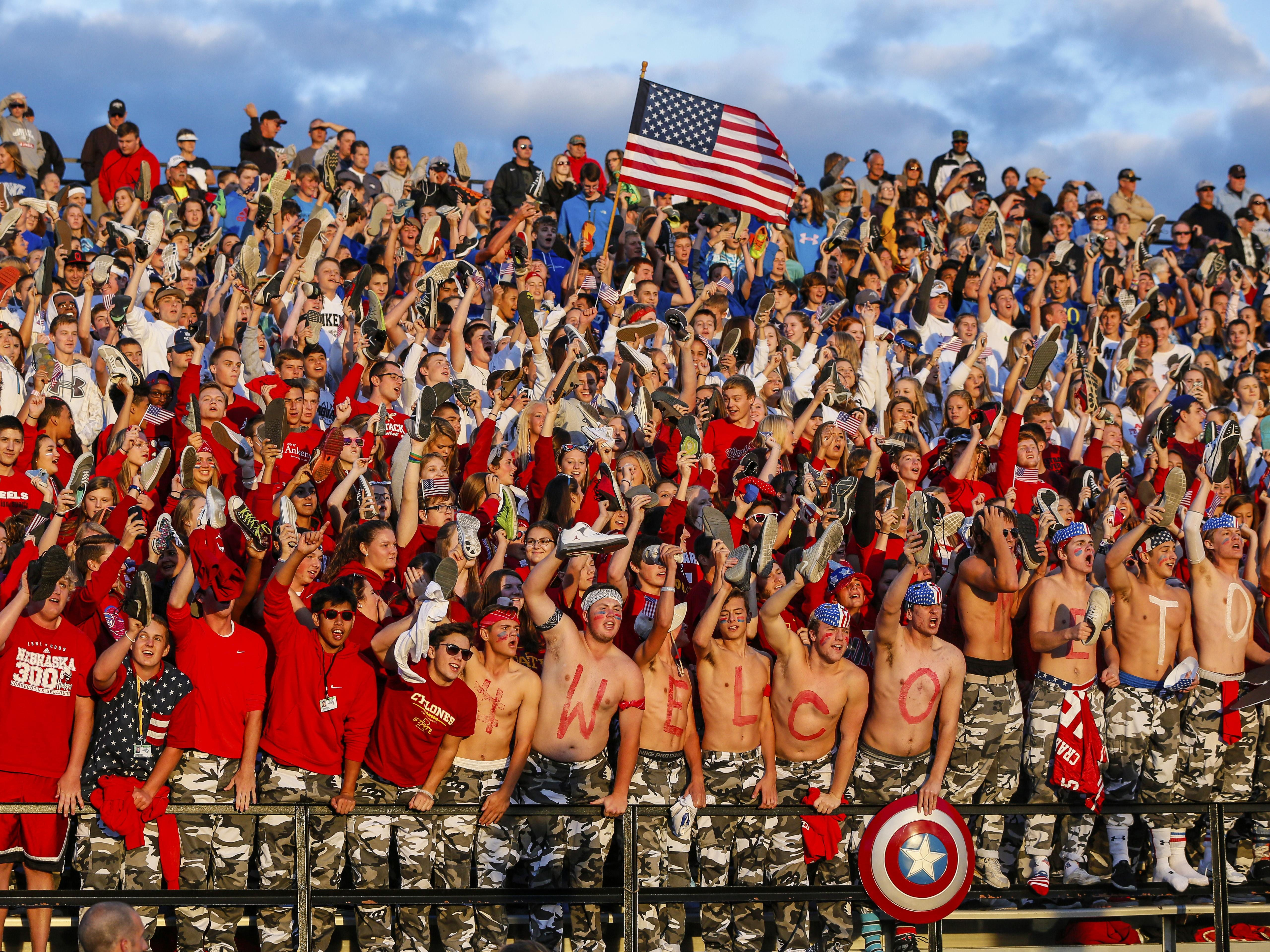 Students cheer Friday during the annual crosstown rivalry game between Ankeny and Ankeny Centennial. Ankeny earned its first win in the three-year series with a 24-16 triumph.
