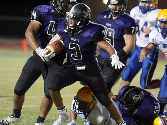 Shadow Hills' Tony Williams jumps over Brawley defenders on his 19 yard run to end zone to score early in the 2nd quarter on Friday in Indio.