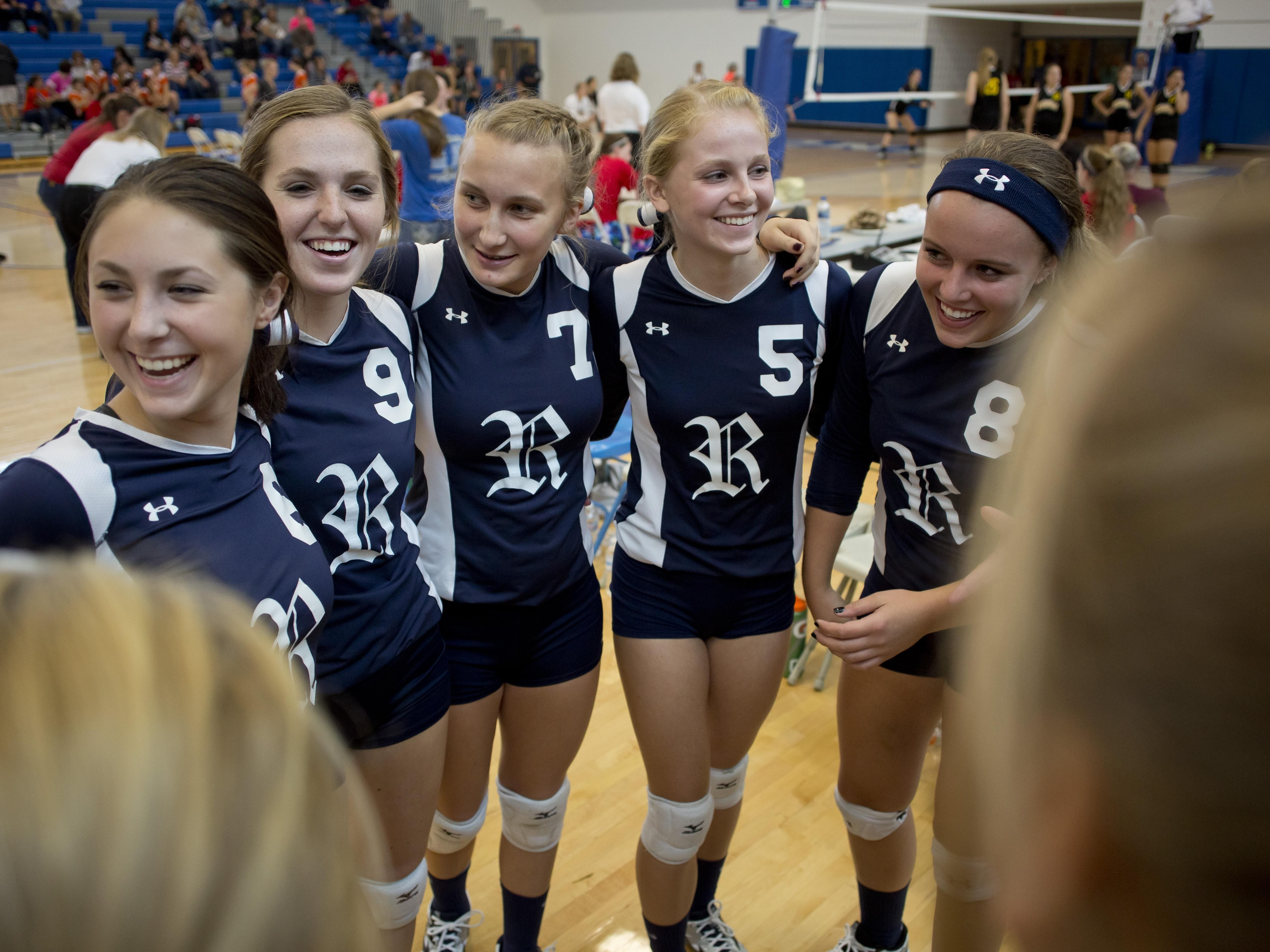 Richmond players get in a huddle during the Pioneer Volleyball Invitational Saturday, September 12, 2015 at Cros-Lex High School.