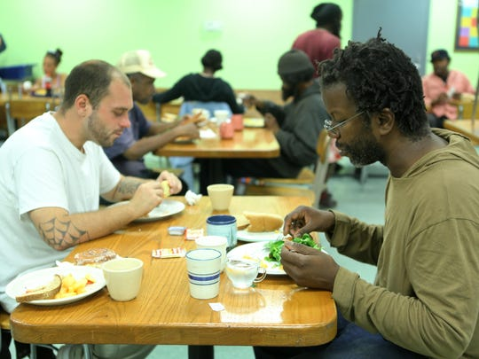 Friday, September 25, 2015: Robert Justice of Price Hill, left, and Joe Bailey of Over-the-Rhine, eat lunch at Our Daily Bread in Over-the-Rhine.