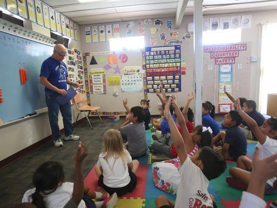 Vista Del Monte Elementary kindergarten teacher Mr. Surrey Tribble teaches his class geometrical concepts on September 17, 2015.