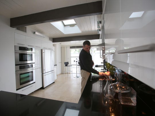 Marduk Sayad, the owner of the Lilliana Gardens Glass House, in the kitchen.