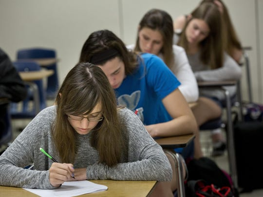 Senior Jenna Taylor works on an exam during an AP calculus class Thursday, September 24, 2015 at Port Huron Northern High School.