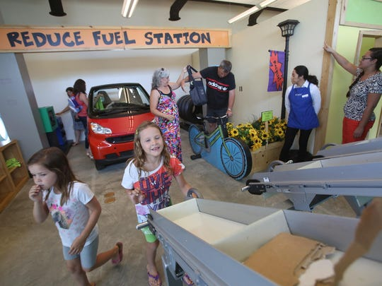 """From left, Carley Rockenstein,5, and her sister Reagan Rockenstein, 6, of Yuba, California visit the traveling exhibit """"Super Kids Save the World"""" at Discovery Children's Museum in Rancho Mirage. The exhibit educates children on issues of environment and sustainability."""