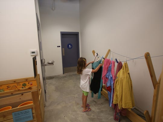 """Carley Rockenstein,5, of Yuba, California visits the traveling exhibit """"Super Kids Save the World"""" at Discovery Children's Museum in Rancho Mirage. The exhibit educates children on issues of environment and sustainability."""