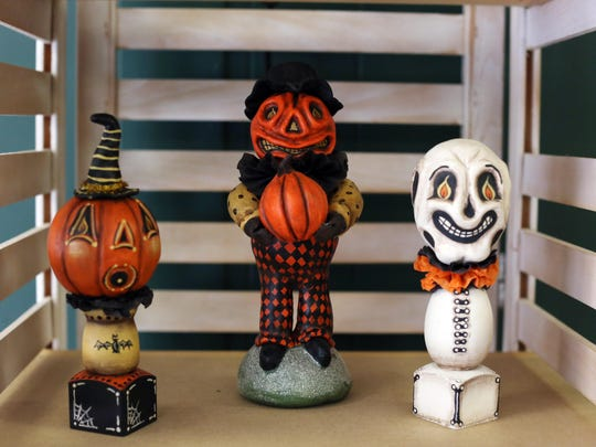 Halloween figures are on display in New London. Chuck McClenning sells his primitive, country and folk art pieces at his Chasmacian Crafter store.