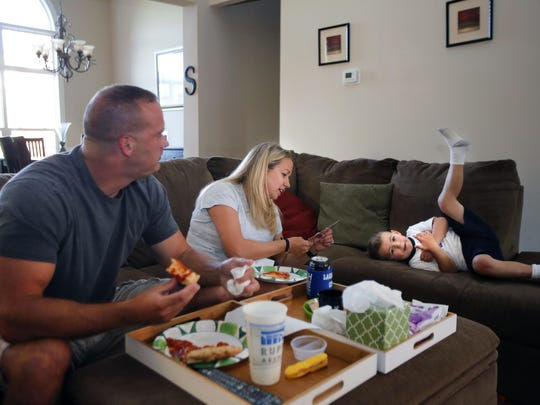 Melanie Lowe, her husband David Stratton, and their son Henry have some pizza for dinner after mom had a long day in court. Aug. 20, 2015