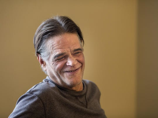 Dec. 7, 2015: Jonathan Kovac laughs in his Avondale apartment. For 15 years, Jonathan Kovac had been mostly drunk and, when not in jail on some charge or another, living on the streets of Clifton. But last Christmas, Greater Cincinnati Behavioral Health Services found him a home. Now, he says he drinks less and his family says that they have a better relationship with him.