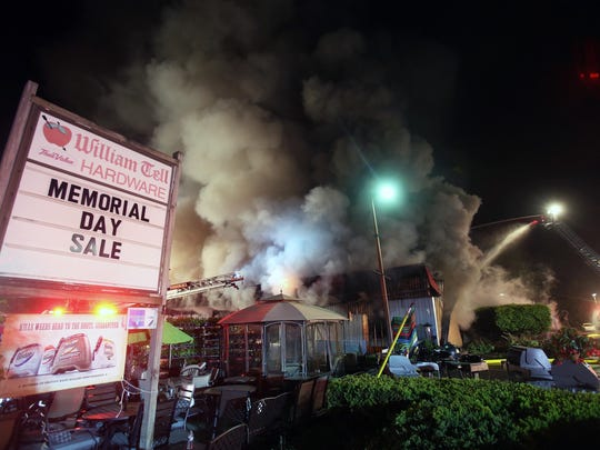 Firefighters from several departments assist East Fishkill firefighters in battling a blaze that destroyed William Tell Hardware on Route 82 in Hopewell Junction.