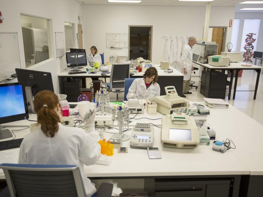 Aimee Shamo, Pat Bradley, Jackie Wayne, and Sara King process genomics samples in the core laboratory at Intermountain Precision Genomics.