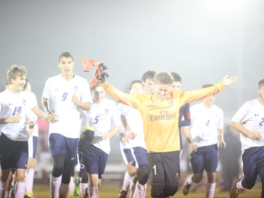 On a misty night, Wakulla goalie Cameron Briggs enjoys the moment with his team following a 2-1 win over Florida High in a Region 1-2A semifinal on Tuesday night.