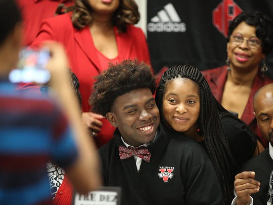 North Florida Christian's Tre'Dez Jones take a photo with aunt Sheronda Green on signing day, Feb. 3, 2016. Jones signed to play football for Valdosta State.
