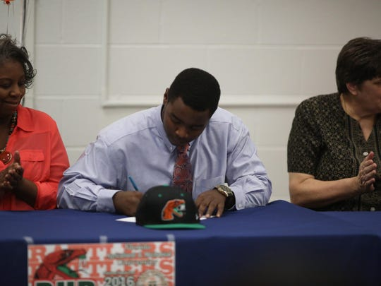 DT Bud Franklin signs with Florida A&M during a ceremony at Wakulla High School.
