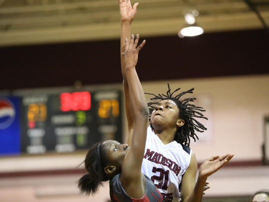Madison County's Jameica Cobb tries to score above a Lafayette defender during Tuesday night's Region 2-1A final.