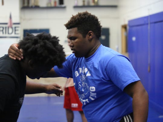 Godby's De'Vaughn Stephens, left, and Demiah Dawsey wrestle on Wednesday, Feb. 10, during a practice at the school's wrestling building.
