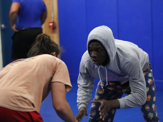 Godby's Andrew Thaxton, left, and Cornelius Brown wrestle on Wednesday, Feb. 10, during a practice at the school's wrestling building.