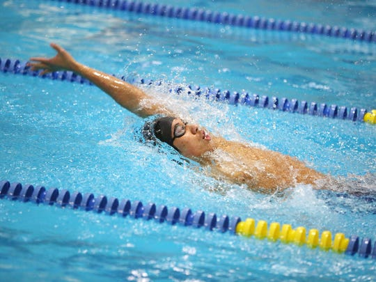 South Salem's Daisuke Fitial competes in the 100 Yard Backstroke during the Greater Valley Conference District meet Friday, Feb. 12, 2016, at the McMinnville Aquatic Center.