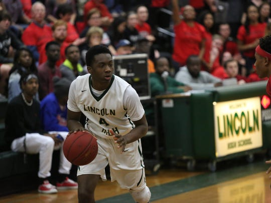 Lincoln sophomore Trinton Bryant tries to drive against Creekside during Friday night's Region 1-7A final.