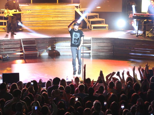 Cole Swindell came out singing with high energy Saturday night at his concert at the Civic Center in Jackson.