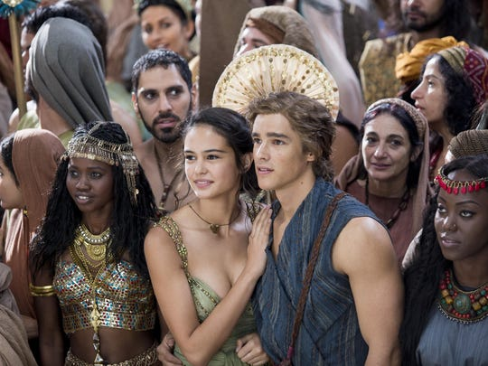 """Courtney Eaton, center left, and Brenton Thwaites, center right, star in """"Gods of Egypt."""" The survival of mankind hangs in the balance as an unexpected mortal hero undertakes a thrilling journey to save the world and rescue his true love."""