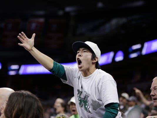 A Hawaii fan reacts during the second half of a second-round men's college basketball game against Maryland in the NCAA Tournament in Spokane, Wash., Sunday, March 20, 2016. Maryland won 73-60. (AP Photo/Young Kwak)