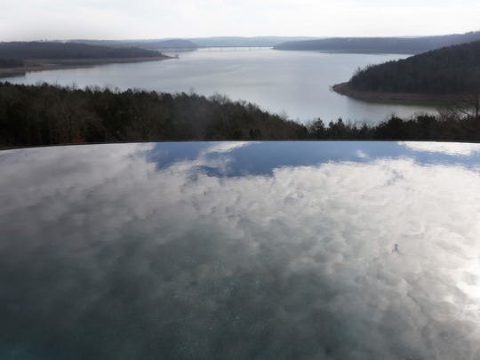 Lydia's Weddings is a wedding venue that overlooks the scenic North Fork Lake. Cynthia Johnson hosts weddings in her beautiful home located just east of Mountain Home, Arkansas. An infinity pool is one of the features of the wedding venue.