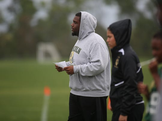 Lincoln assistant flag football coach Brandon McCray calls out offensive plays against Apopka in the Capital City Classic.