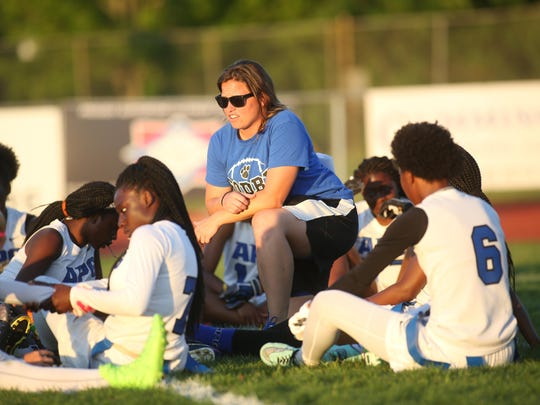 Godby coach Chelsea Parmer talks to her team at halftime.