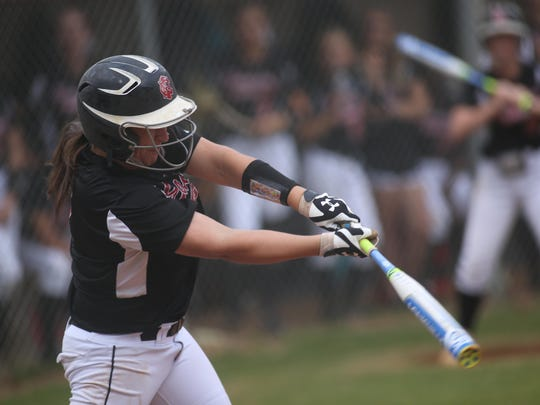 NFC's Katelyn Wood knocks a hit during Tuesday afternoon's District 1-3A semifinal between NFC and Maclay, which turned into an offensive slugfest as the Eagles topped the Marauders 15-11.