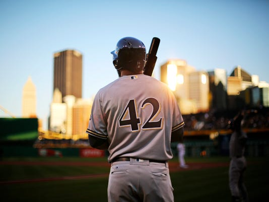 Milwaukee Brewers' Domingo Santana waits on-deck before a baseball game against the Pittsburgh Pirates in Pittsburgh, Friday, April 15, 2016. All players wore the No. 42 in honor of Jackie Robinson Day. (AP Photo/Gene J. Puskar)