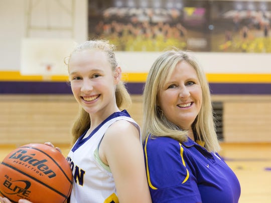 Mary Ward and daughter Emily enjoy the sport of basketball together. Mary coaches the team Emily plays on for the Benton Tigers.
