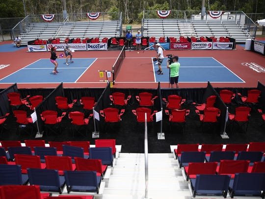 Professionals play pickleball in a friendly match Tuesday,