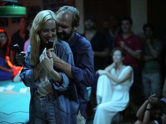 "Dakota Johnson and Ralph Fiennes in ""A Bigger Splash."""