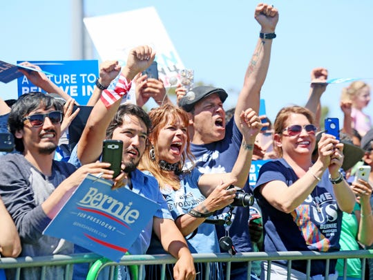 Supporters cheer while listening to Democratic presidential
