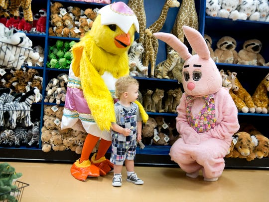 Landon Crowe, 1, takes a closer look at the Easter bunny and his friend the yellow chick during a meet and greet breakfast at the Naples Zoo Friday, March 25, 2016. Unfortunately, due to inclement weather, the event was cut short and guests sent home after they had a chance to pose with the Easter Bunny. (Luke Franke/Staff)