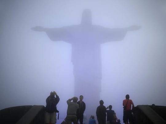 The Christ the Redeemer statue is covered by heavy fog in Rio de Janeiro, Brazil.