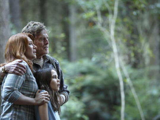 "Bryce Dallas Howard is Grace, Robert Redford is Mr. Meacham and Oona Laurence is Natalie in ""Pete's Dragon."""
