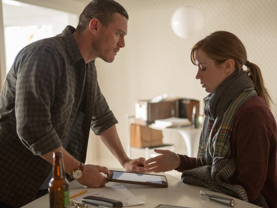 """Luke Evans and Emily Blunt in """"The Girl on the Train."""""""