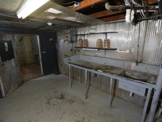 The autopsy table still remains in the basement when the hotel was operated by Norman Baker as the Baker Cancer Curing Hospital, a facility that bilked cancer patients and saw most meet their death.