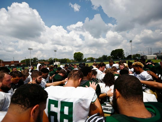 """The UAB football team gathers after practice Thursday, Aug. 25, 2016, in Birmingham, Ala. UAB broke ground on a two-story, 46,000-square-foot two-story facility that will include offices, locker rooms, weight rooms and more. """"The football facilities that we've had are beyond antiquated so we really in our view are creating these for the first time,"""" UAB athletic director Mark Ingram said. """"We've been operating here with nearly nothing in terms of football facilities and now we're going to have this dramatic, impressive training center that we've not had. (AP Photo/Brynn Anderson)"""