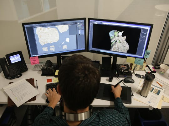 Arthrex 3D Animation Supervisor Patrick Eckhold works on animations at the Arthrex offices in Naples in October.