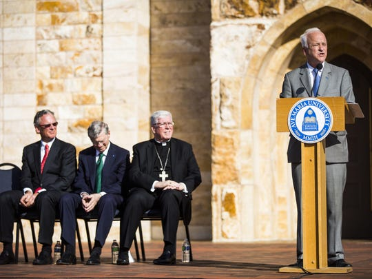 Ave Maria University President Jim Towey speaks on Jan. 19, 2017, during a presentation for the university's sale of its oratory building to The Diocese of Venice, which elevated its status from Quasi Parish to Parish. Seated, from left, are university board chairman Michael T. O. Timmis, Ave Maria University founder Tom Monaghan and Bishop Frank J. Dewane.