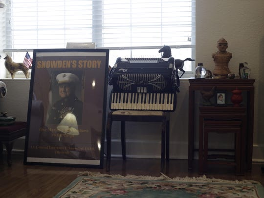 General Snowden's apartment in Westminster Oaks is stuffed with memorabilia and accolades, such as this poster bearing the cover of his book.