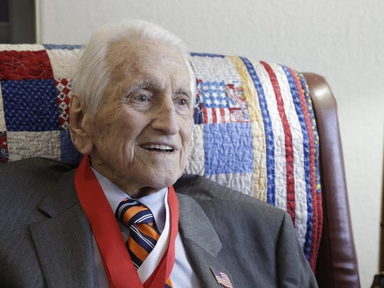 For many years Lt. General Lawrence Snowden, USMC (Retired), pictured here at his apartment in Westminster Oaks, organized Joint Reunions of Honor to recognize soldiers on both sides of the Battle of Iwo Jima, in which he served.