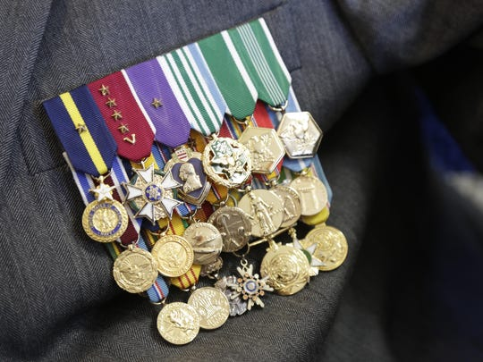 General Snowden's Purple Heart almost disappears amongst the medals weighing down his blazer.