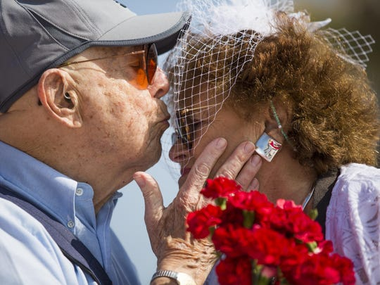 Stanley Cronig kisses his wife, Cynthia, on the forehead after exchanging vows Tuesday at Lovers Key. The got engaged when Cynthia proposed to Stanley during fireworks at Martha's Vineyard. They've been married for 61 years.